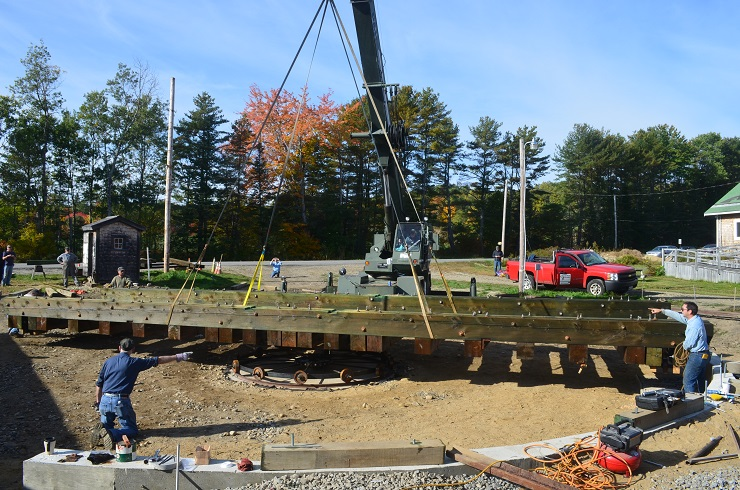 The turntable is placed by a crane during the Fall Work Weekend.