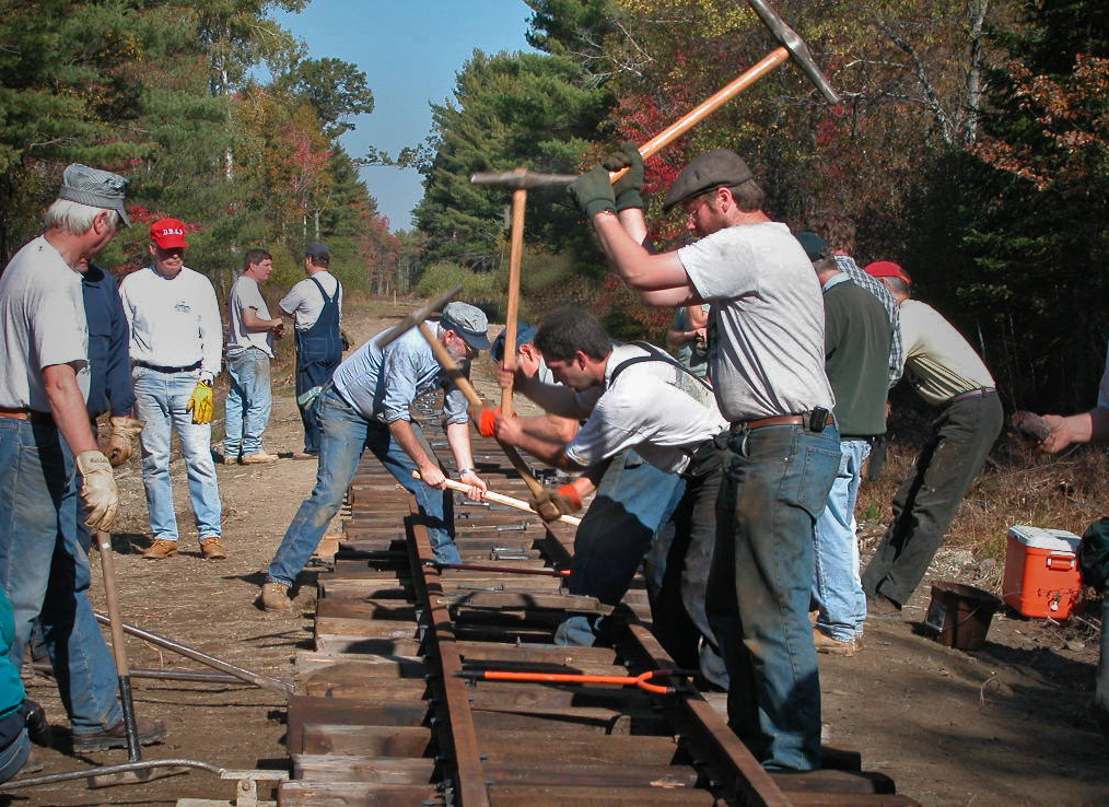 Volunteer crews spiking track in 2003.  There's 4 spikers in this picture.