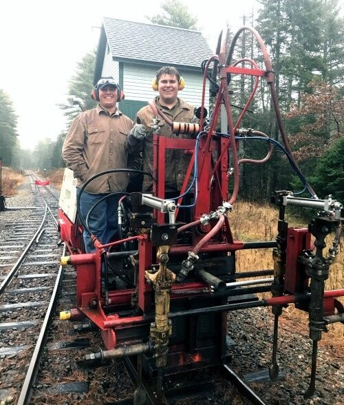 Tamper operators doing track maintenance
